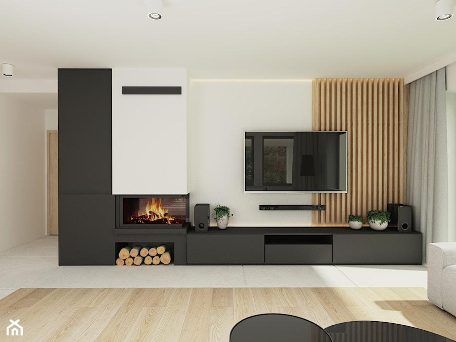 Aranżacja wnętrz domu jednorodzinnego. - Średni biały czarny salon - zdjęcie od Studio projektowe Suzume