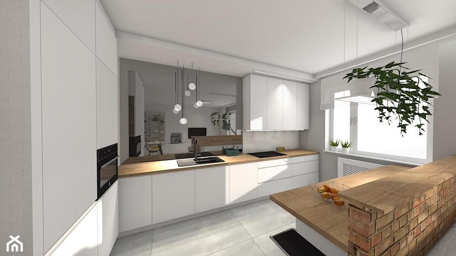Projekt mieszkania w Krakowie - Duża szara kuchnia w kształcie litery l w aneksie z wyspą z oknem - zdjęcie od Studio FORMAT HOME