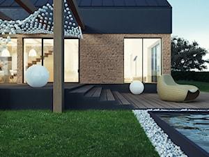 Dom w stylu skandynawskim - Średni ogród za domem z basenem - zdjęcie od FORMAarchitekci