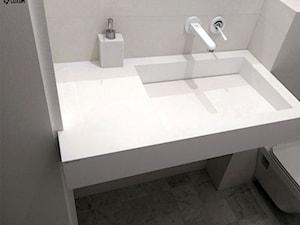 Nowoczesna biała umywalka z blatem na wymiar.