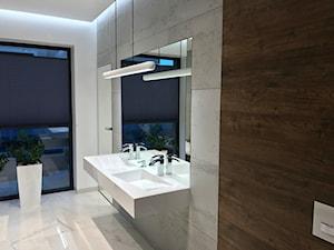 Łazienka w szarościach? Postaw na beton architektoniczny!