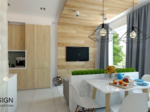 Salon z aneksem kuchennym i jadalnią. - zdjęcie od Fi Design