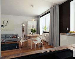 Kuchnia z salonem 32 m2 - Mała otwarta biała jadalnia w salonie, styl minimalistyczny - zdjęcie od Fi Design