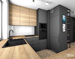Eklektyczne mieszkanie w Gdyni - Średnia otwarta biała czarna kuchnia w kształcie litery g z oknem, styl eklektyczny - zdjęcie od black design