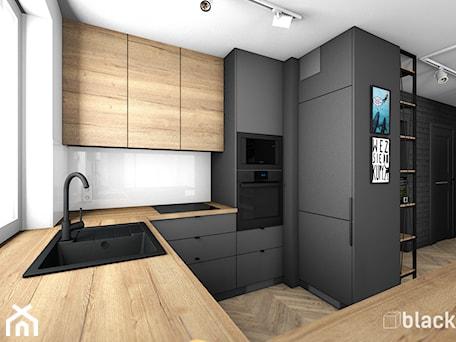 Aranżacje wnętrz - Kuchnia: Eklektyczne mieszkanie w Gdyni - Średnia otwarta biała czarna kuchnia w kształcie litery g z oknem, styl eklektyczny - black design. Przeglądaj, dodawaj i zapisuj najlepsze zdjęcia, pomysły i inspiracje designerskie. W bazie mamy już prawie milion fotografii!