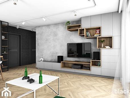 Aranżacje wnętrz - Salon: Eklektyczne mieszkanie w Gdyni - Średni szary biały czarny salon z jadalnią, styl nowoczesny - black design. Przeglądaj, dodawaj i zapisuj najlepsze zdjęcia, pomysły i inspiracje designerskie. W bazie mamy już prawie milion fotografii!