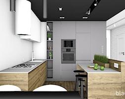 Mieszkanie 48m2. - Średnia otwarta biała kuchnia w kształcie litery l w aneksie z wyspą, styl nowoczesny - zdjęcie od black design