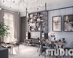 Styl industrialny - Średni szary salon z bibiloteczką, styl nowoczesny - zdjęcie od =mlamp.pl=   rozświetlamy wnętrza