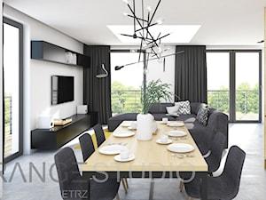 Dom w Chorzowie - Duża otwarta szara jadalnia w salonie, styl nowoczesny - zdjęcie od ORANGE STUDIO