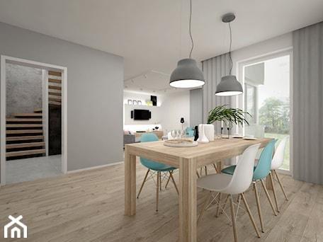 Aranżacje wnętrz - Jadalnia: Projekt domu 70 m2 / Jabłonka - Średnia otwarta biała szara jadalnia jako osobne pomieszczenie, styl skandynawski - BIG IDEA studio projektowe. Przeglądaj, dodawaj i zapisuj najlepsze zdjęcia, pomysły i inspiracje designerskie. W bazie mamy już prawie milion fotografii!