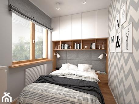 Aranżacje wnętrz - Sypialnia: Projekt mieszkania 30 m2 / Kraków - Mała biała szara sypialnia dla gości, styl skandynawski - BIG IDEA studio projektowe. Przeglądaj, dodawaj i zapisuj najlepsze zdjęcia, pomysły i inspiracje designerskie. W bazie mamy już prawie milion fotografii!