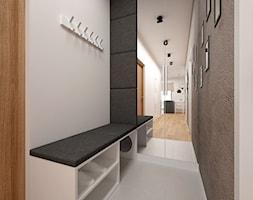 Projekt mieszkania 60 m2 / Kraków - Mały biały szary hol / przedpokój, styl minimalistyczny - zdjęcie od BIG IDEA studio projektowe - Homebook