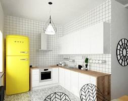 Kuchnia w skandynawskim stylu, biała płytka, żółty kolor akcentowy - zdjęcie od Alina Shevchenko Interiors - Homebook