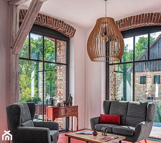 Sofa na wysokich nóżkach – idealne rozwiązanie do małego salonu