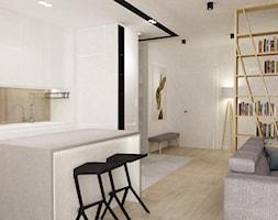 mieszkanie w bieli - Mała otwarta biała kuchnia w kształcie litery l w aneksie z wyspą, styl minimalistyczny - zdjęcie od Grafika i Projekt architektura wnętrz
