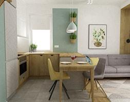 Pastelowe 48m2 - Mała otwarta biała zielona kuchnia w kształcie litery u w aneksie z oknem, styl skandynawski - zdjęcie od Grafika i Projekt architektura wnętrz