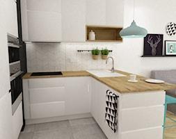 kawalerka do wynajęcia 35m2 - Mała otwarta biała kuchnia w kształcie litery u w aneksie, styl skandynawski - zdjęcie od Grafika i Projekt architektura wnętrz