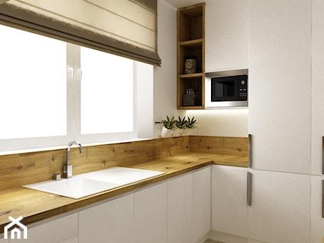 Aranżacje wnętrz - Kuchnia: kuchnia w bieli,drewnie z dodatkami czarnego - metamorfoza - Średnia biała kuchnia w aneksie, styl ... - Grafika i Projekt architektura wnętrz. Przeglądaj, dodawaj i zapisuj najlepsze zdjęcia, pomysły i inspiracje designerskie. W bazie mamy już prawie milion fotografii!