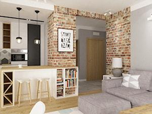 mieszkanie 50m2 w warszawie - Mały szary salon z kuchnią z jadalnią, styl skandynawski - zdjęcie od Grafika i Projekt architektura wnętrz