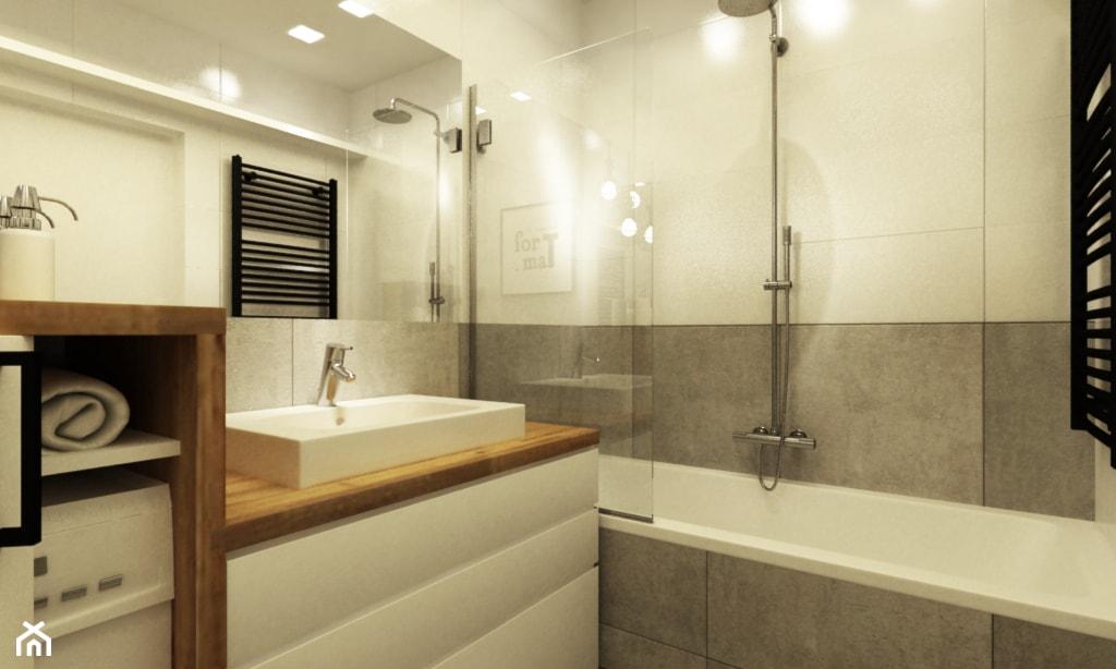 mała łazienka z wanną z parawanem, szare płytki łazienkowe