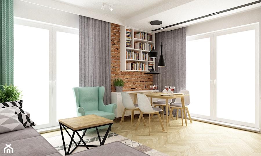 mieszkanie 50m2 w warszawie - Duży salon z bibiloteczką z jadalnią, styl skandynawski - zdjęcie od Grafika i Projekt architektura wnętrz
