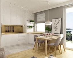 kawalerka 35m2 - Średnia biała szara kuchnia w kształcie litery u w aneksie z oknem, styl skandynawski - zdjęcie od Grafika i Projekt architektura wnętrz