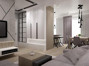 dwupoziomowe  mieszkanie w zimnych odcieniach drewna i szarościach
