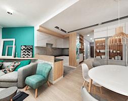 Mieszkanie w Katowicach 65m² - Średnia otwarta szara turkusowa jadalnia w salonie, styl skandynawski - zdjęcie od More-IN Architekci