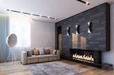 szara ściana z kamienia dekoracyjnego, drewniana podłoga, szary dywan, biokominek w salonie