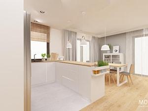 Salon z kuchnią i jadalnią - zdjęcie od MOTHI.form
