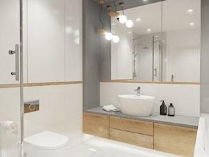 Szukam idealnej szarości do moich mebli łazienkowych. Czy można prosić o podpowiedź, jaki odcień został użyty w tej łazience? Dziękuję z góry.