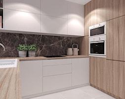 Mieszkanie w kameralnej dzielnicy na uboczu miasta. - Średnia zamknięta biała beżowa kuchnia w kształcie litery u, styl nowoczesny - zdjęcie od Agata Hann Architektura Wnętrz