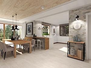 Dom pod Kołobrzegiem w zacisznym miejscu. - Duża otwarta biała jadalnia jako osobne pomieszczenie, styl rustykalny - zdjęcie od Agata Hann Architektura Wnętrz