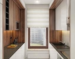 INTERIOR | Mieszkanie - Warszawa - Mała zamknięta wąska biała kuchnia dwurzędowa, styl nowoczesny - zdjęcie od Manufaktura Projektów
