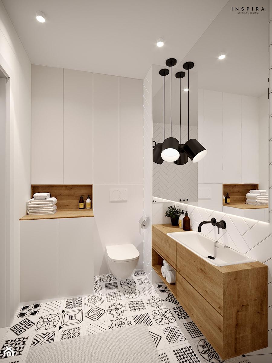 W jodełkę - Średnia biała szara łazienka bez okna, styl skandynawski - zdjęcie od Inspira Design