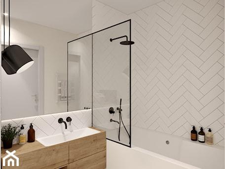 Aranżacje wnętrz - Łazienka: W jodełkę - Średnia biała łazienka bez okna, styl skandynawski - Inspira Design. Przeglądaj, dodawaj i zapisuj najlepsze zdjęcia, pomysły i inspiracje designerskie. W bazie mamy już prawie milion fotografii!