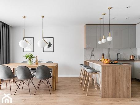 Aranżacje wnętrz - Jadalnia: Zielona elegancja - Średnia otwarta biała jadalnia w kuchni, styl nowoczesny - Studio Projekt. Przeglądaj, dodawaj i zapisuj najlepsze zdjęcia, pomysły i inspiracje designerskie. W bazie mamy już prawie milion fotografii!