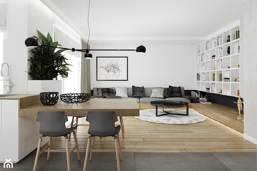Mieszkanie w Warszawie - Duży biały salon z kuchnią z jadalnią, styl nowoczesny - zdjęcie od Ewelina Witkowska Architektura Wnętrz
