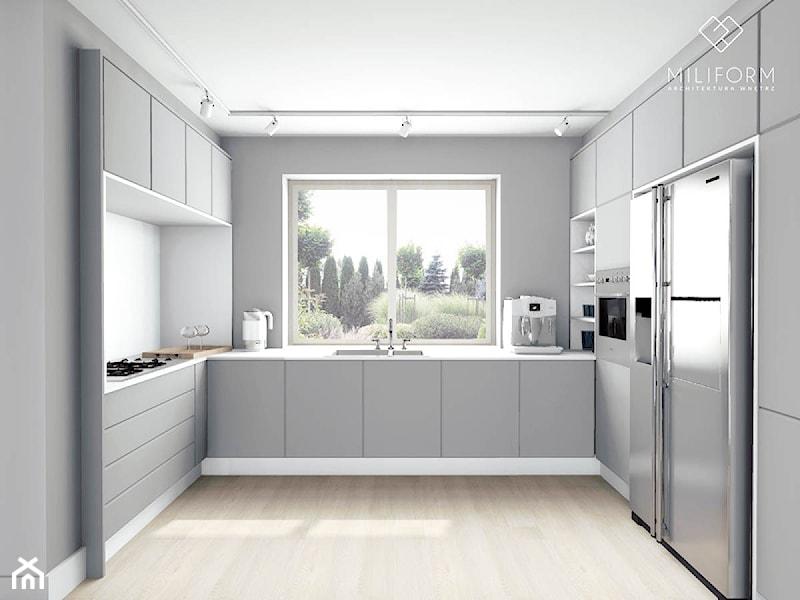 Witam, Z czego wykonany jest blat i biała ściana między   -> Kuchnia Czarno Siwa
