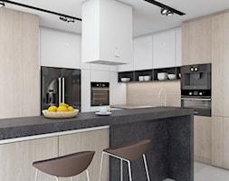 DOM JEDNORODZINNY D12/2015 TARNOWSKIE GÓRY - Średnia otwarta kuchnia w kształcie litery l z wyspą, styl nowoczesny - zdjęcie od A2 STUDIO pracownia architektury