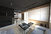 podłoga z jasnego drewna, grafitowe ściany, czarny stolik na metalowych nogach, szara sofa, kominek
