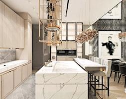 jasna+kuchnia+ze+z%C5%82otymi+detalami+-+zdj%C4%99cie+od+ARTDESIGN+architektura+wn%C4%99trz