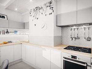 Delikatne beże i szarości - Średnia zamknięta szara kuchnia w kształcie litery l, styl skandynawski - zdjęcie od JedyneTakieWnętrza