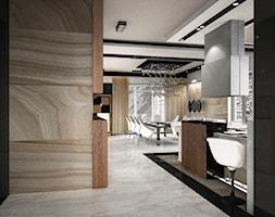 Dom pokazowy w Ożarowie - Duża otwarta czarna szara jadalnia w kuchni w salonie - zdjęcie od BAUART STUDIO Pracownia Architektury
