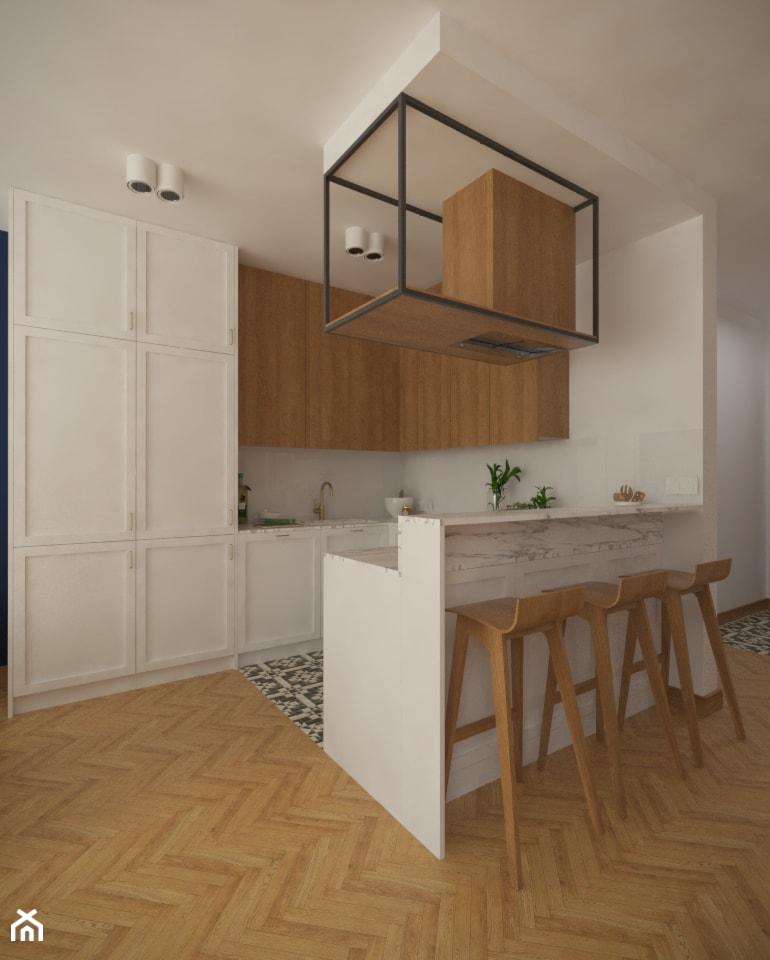 Biało-drewniana kuchnia z wyspą. - zdjęcie od Studio Monocco