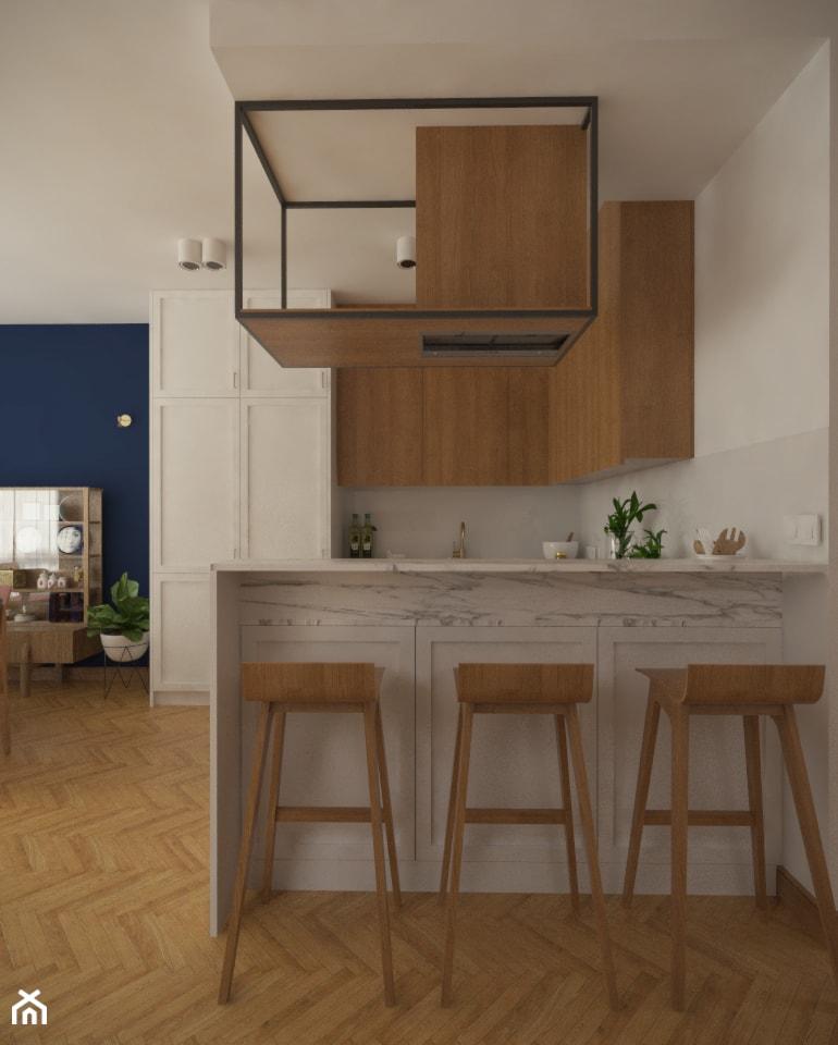 Wyspa w kuchni z metalowo-drewnianą konstrukcją okapu. - zdjęcie od Studio Monocco