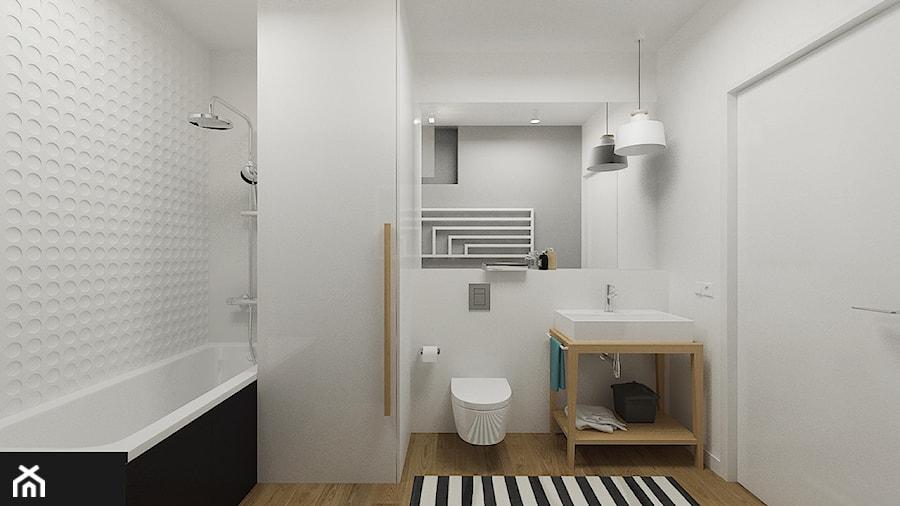 MIESZKANIE 49,5M² – POZNAŃ - Średnia biała łazienka w bloku w domu jednorodzinnym bez okna, styl skandynawski - zdjęcie od Devangari Design