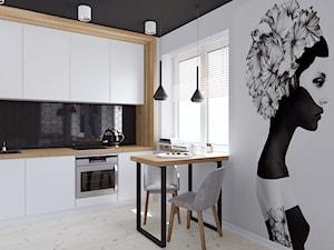 Mieszkanie z elementami drewna - Mała biała czarna kuchnia jednorzędowa w aneksie z oknem - zdjęcie od Illa Design