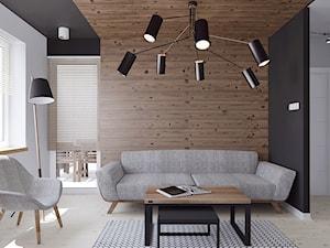 Mieszkanie z elementami drewna - Średni biały czarny salon, styl minimalistyczny - zdjęcie od Illa Design