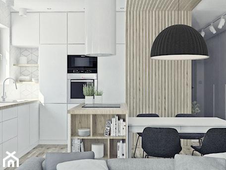 Aranżacje wnętrz - Kuchnia: Mieszkanie w skandynawskim stylu - Średnia biała kuchnia w kształcie litery l w aneksie z wyspą z oknem, styl skandynawski - Illa Design. Przeglądaj, dodawaj i zapisuj najlepsze zdjęcia, pomysły i inspiracje designerskie. W bazie mamy już prawie milion fotografii!